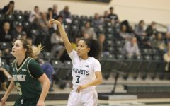 Sac State junior guard Tiara Scott watches as her 3-pointer goes in to give her team a 87-82 lead with 13.5 seconds left in the game against Cal Poly on Nov. 11 at the Nest. The Hornets beat the Mustangs in the season opener 88-85.