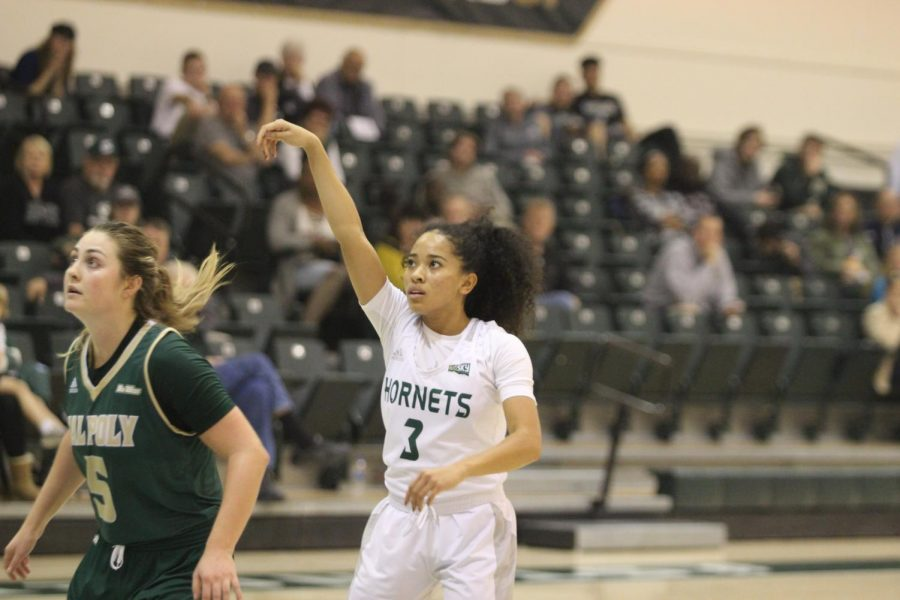 Sac+State+junior+guard+Tiara+Scott+watches+as+her+3-pointer+goes+in+to+give+her+team+a+87-82+lead+with+13.5+seconds+left+in+the+game+against+Cal+Poly+on+Nov.+11+at+the+Nest.+The+Hornets+beat+the+Mustangs+in+the+season+opener+88-85.