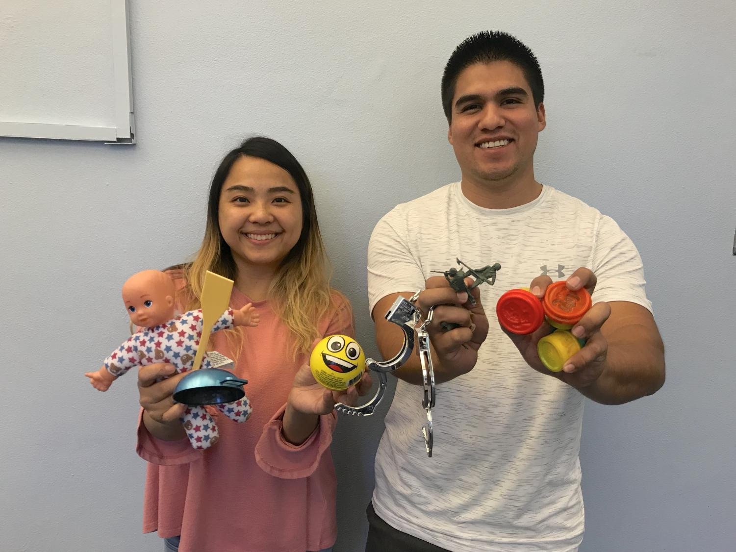 Bao Vang (left) and Humberto Ramirez (right) are graduate students in the counseling program at Sac State learning how to apply play therapy with children.