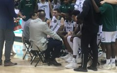 Sac State head coach Brian Katz talks to the team during a timeout in the second half of the Hornets 76-52 win over Simpson University on Friday.