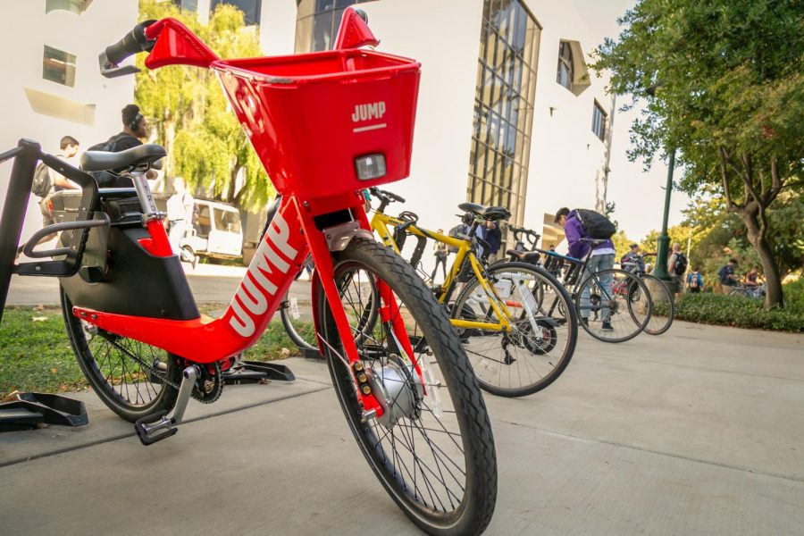 A bicycle from the company JUMP sits in at a  bike rack between Del Norte and Mendocino Hall. JUMP announced to increase their on-demand bicycle services by over 50 percent in the Sacramento area.