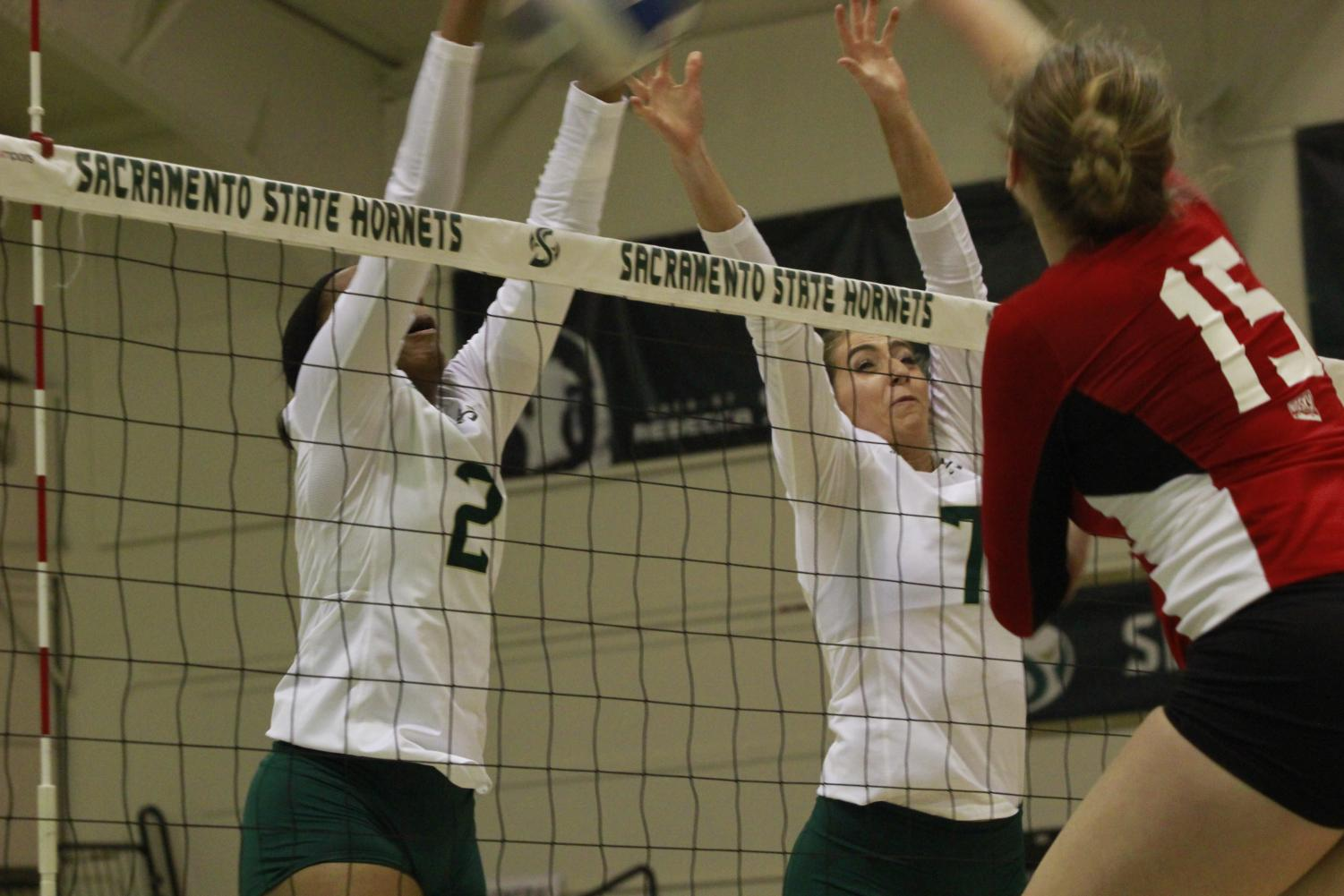 Cianna Andrews (2) and Lana Brown (7) go up for a block in Sac State's win over Eastern Washington on Thursday. The Hornets are now 10-3 in the Big Sky Conference.