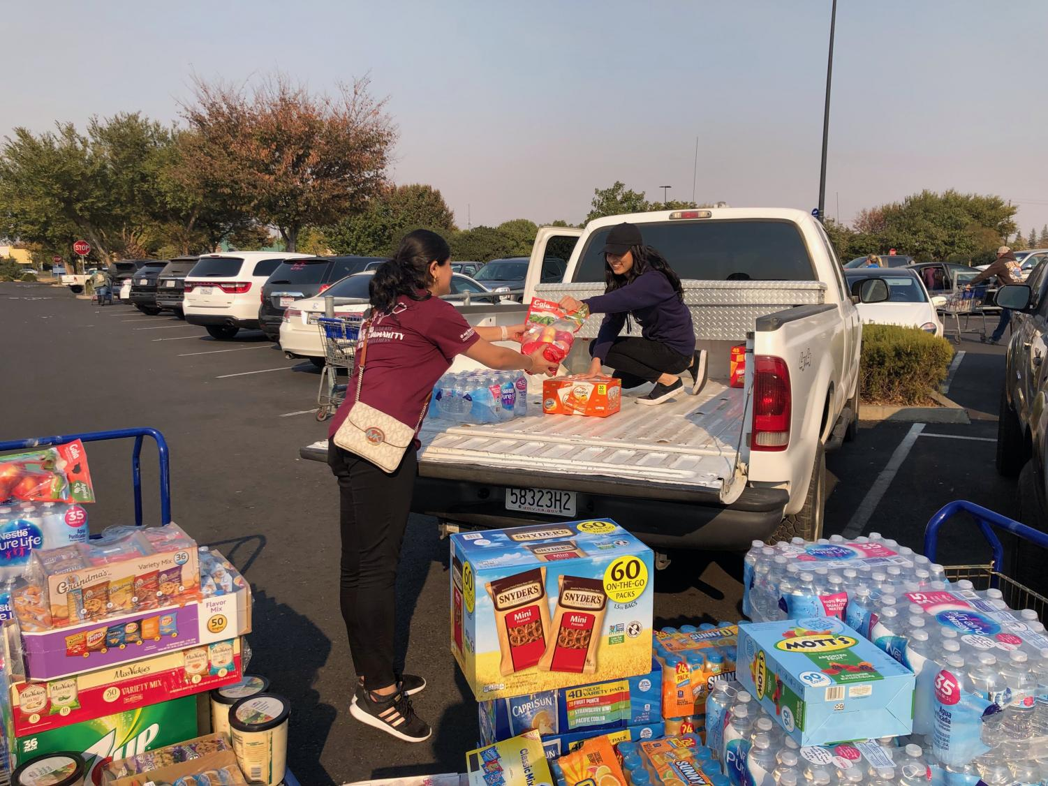 Bhagat Puran Singh Health Initiative's Jaskaran Nijjar, vice president, and Samreet Kaur, supplies manager and social media coodinator. Sac State's BPSHI service club donated food and menstrual products to Butte County shelters Sunday, Nov. 11, 2018.