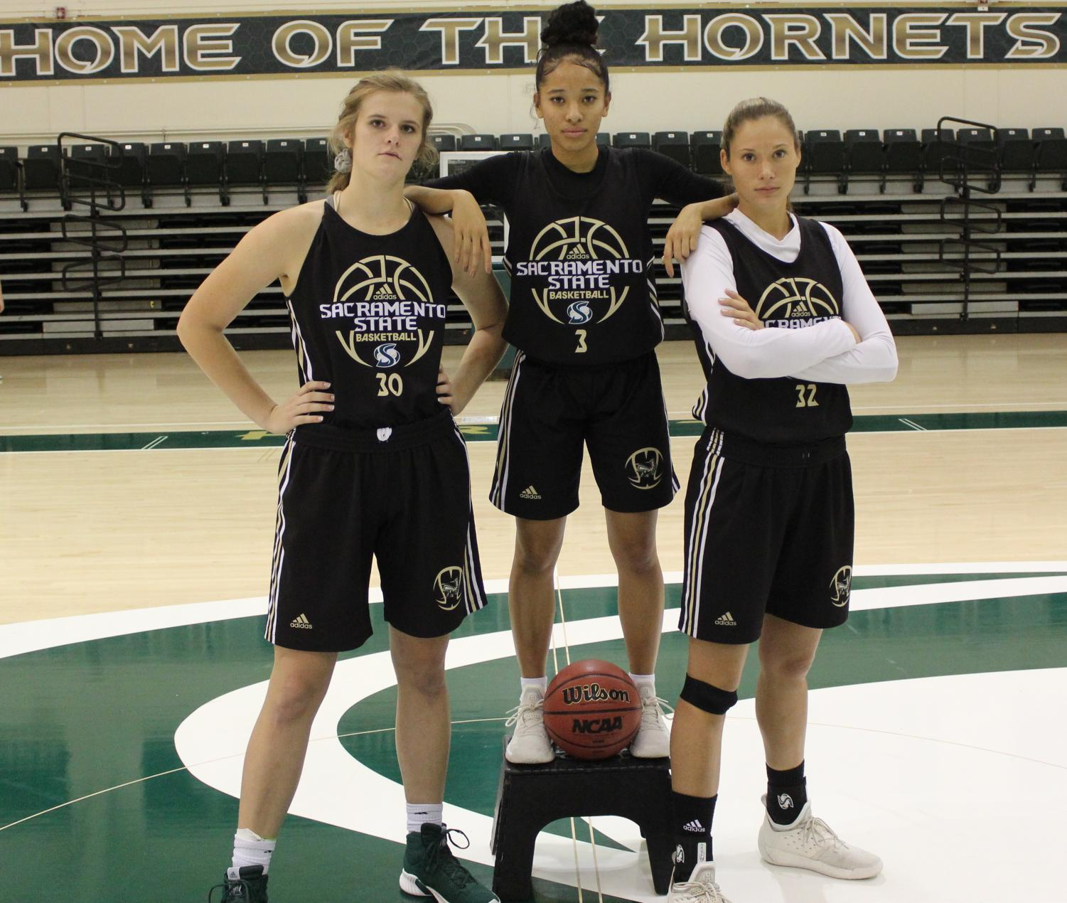 Juniors (from left to right) Kennedy Nicholas, Tiara Scott and Hannah Friend, re-enact the Cleveland Cavaliers famous