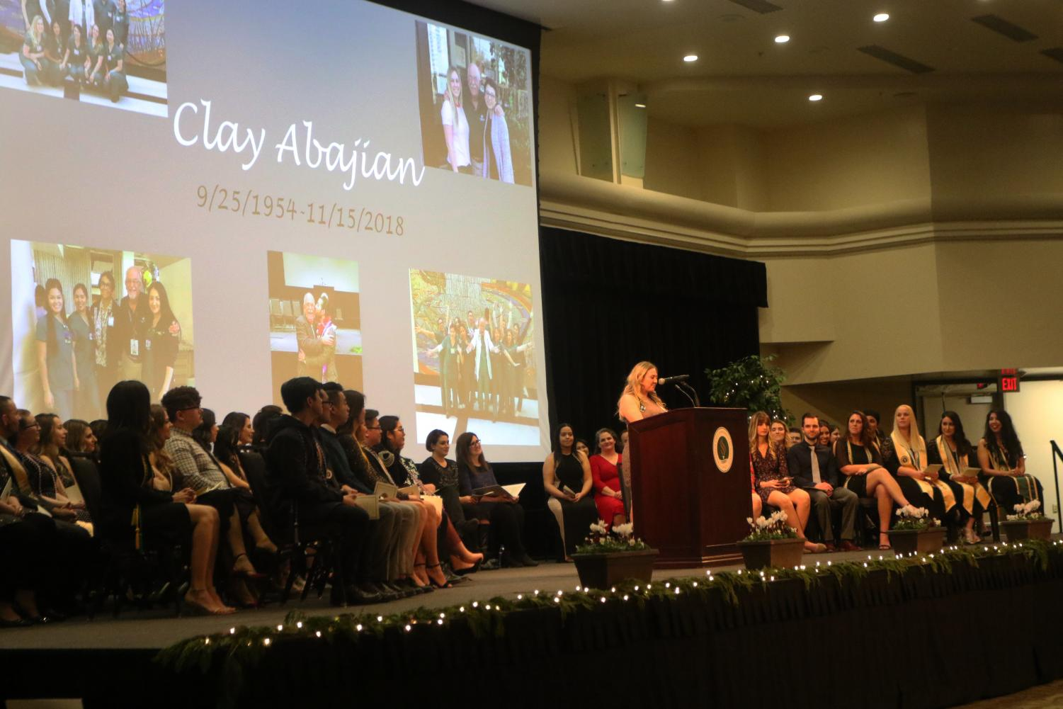 Annie Mantsch reads an in memoriam speech in honor of nursing instructor Clay Abajian at Sacramento State's School of Nursing pinning ceremony Thursday in the University Union Ballroom. Abajian was one of two fatalities in a Nov. 15 plane crash in Redding, California.