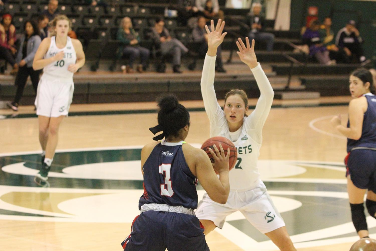 Sac State junior forward Hannah Friend guards an Antelope Valley player during the Hornets 86-80 win Saturday.