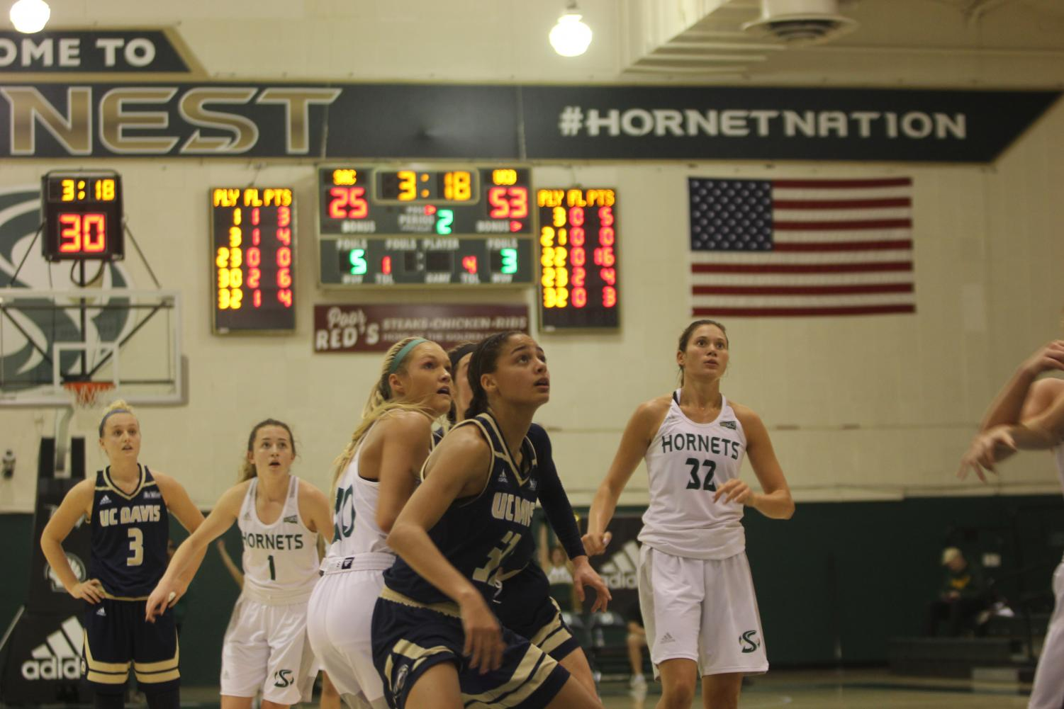 Players on both teams anticipate a rebound following a free-throw attempt by Sac State junior guard Hannah Friend in a 109-60 loss to UC Davis at the Nest on Dec. 7.