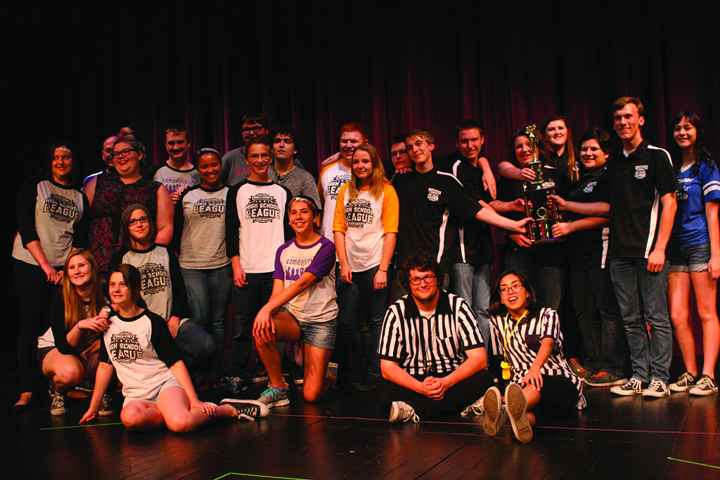 This is me, sitting in stripes toward center, after a full day of hosting ComedySportz matches for High School League teams. This day, and many others in the last six years, will be ingrained in my memory forever for how fun, uplifting and inspiring it was. I would forget the haircut if I could.