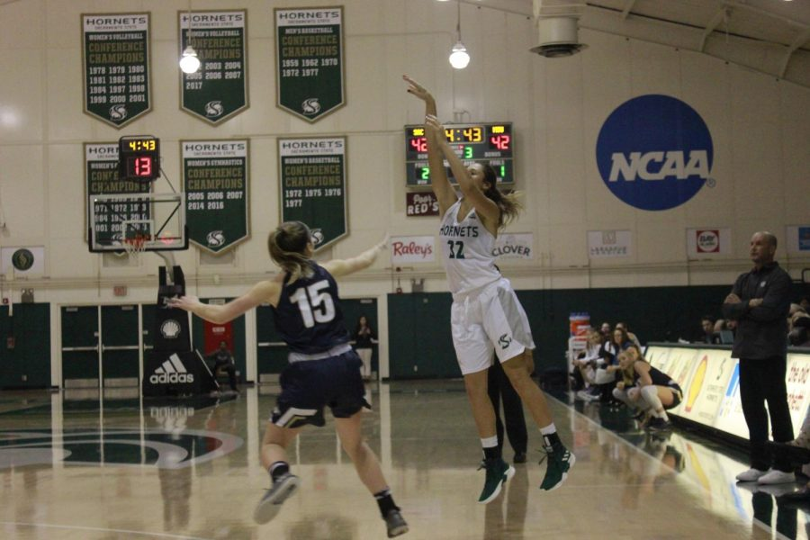 Sac+State+junior+guard+Hannah+Friend+shoots+a+three+pointer+in+a+69-53+loss+against+Montana+State+at+the+Nest+on+Jan.+5.