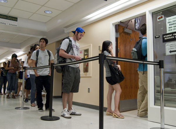 Sac State students wait in line for the bursar's office at Lassen Hall in 2010. Anita Kermes, financial aid director, has promised support for students unable to finish filling out their financial aid applications for the Spring 2019 semester due to a government shutdown.