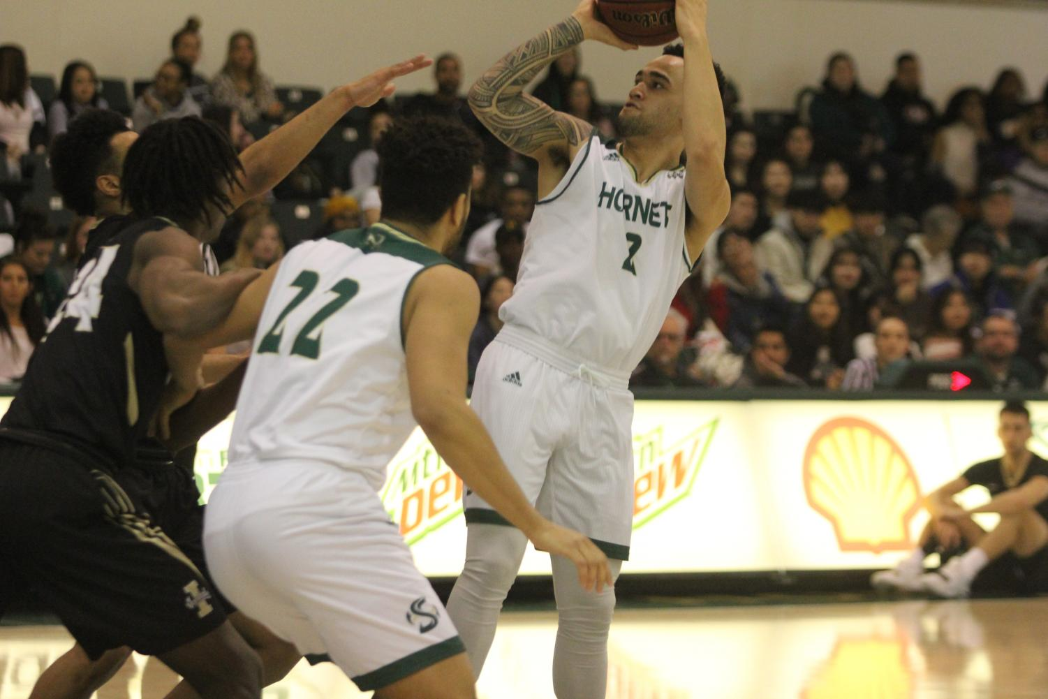 Sac State senior guard Izayah Mauriohooho-Le'afa shoots in the first half of the Hornets 69-48 win against University of Idaho on Jan. 24 at the Nest. The senior currently leads the team in 3-point shot attempts and makes.