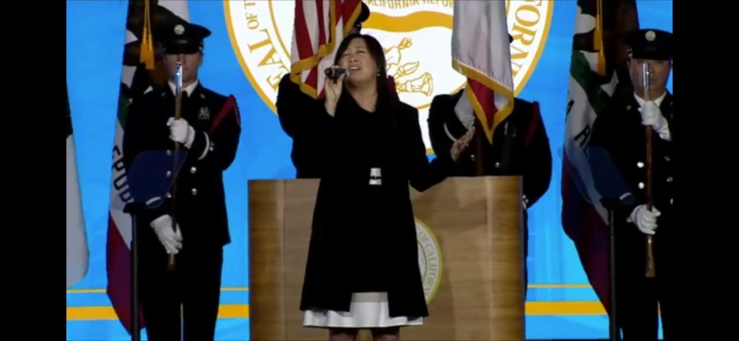 Gaw Vang Williams sings the National Anthem at Governor Gavin Newsom's inauguration in Sacramento, California on Jan. 7. Williams is the vocal jazz director for the Sac State School of Music.