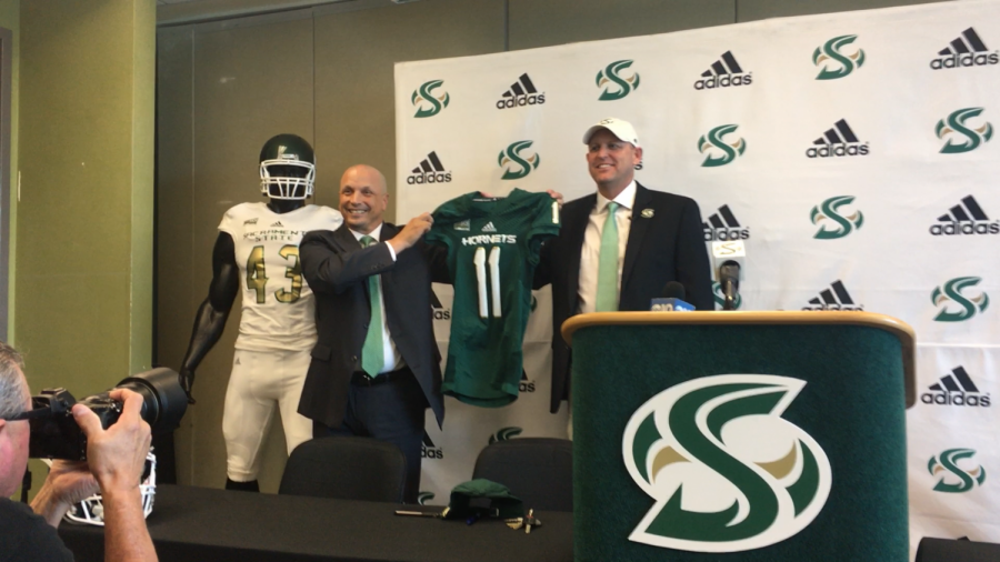 Sac+State+Athletic+Director+Mark+Orr+%28left%29+and+new+Sac+State+football+coach+Troy+Taylor+hold+up+a+jersey+at+Taylor%27s+introductory+press+conference+Dec.+18+at+Broad+Fieldhouse.