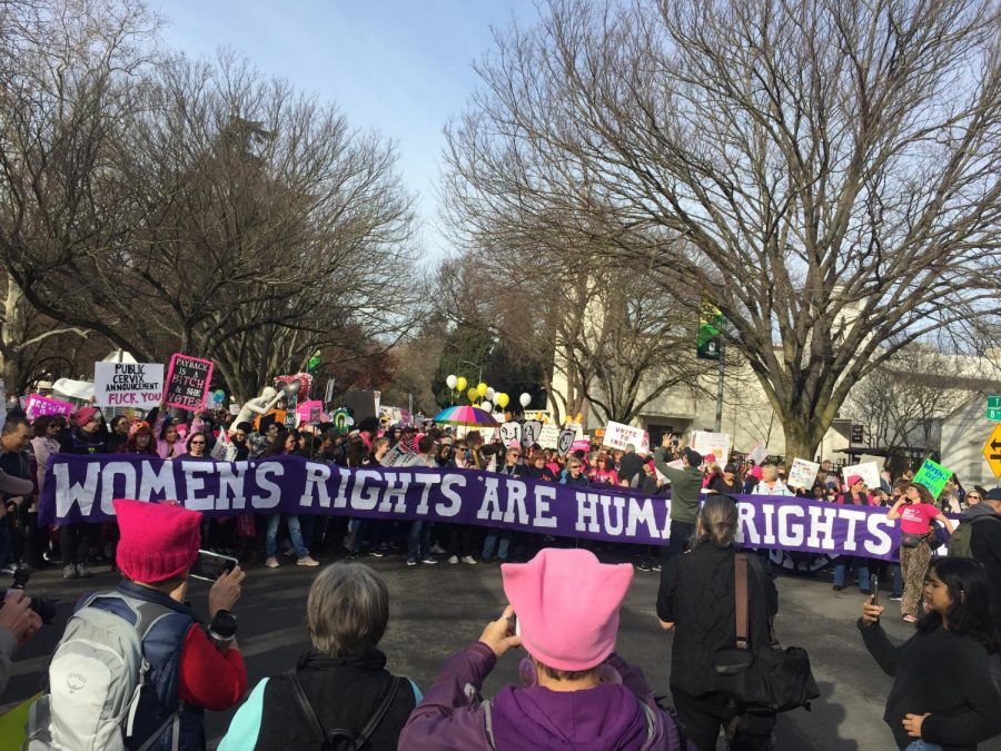 Demonstrators+rally+at+the+corner+of+T+st+and+7th+St.+before+marching+to+the+Capitol.+The+slogan+%22Women%27s+Rights+are+Human+Rights+has+its+roots+going+back+to+the+1800s+but+was+popularized+by+a+speech+Hilary+Clinton+gave+in+1995.