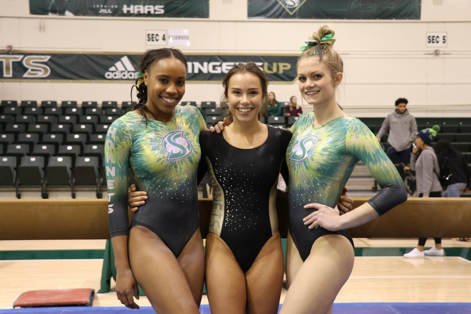 From left Jordyn Brent, Lauren Schmeiss and Jackie Sampson pose at the Nest after a meet. The three will be counted on for at least three routines each this season.