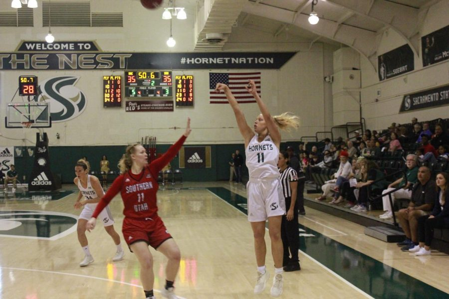 Sac+State+freshman+guard+Summer+Menke+shoots+a+three-pointer+in+a+77-76+win+against+Southern+Utah+on+Jan.+19.+