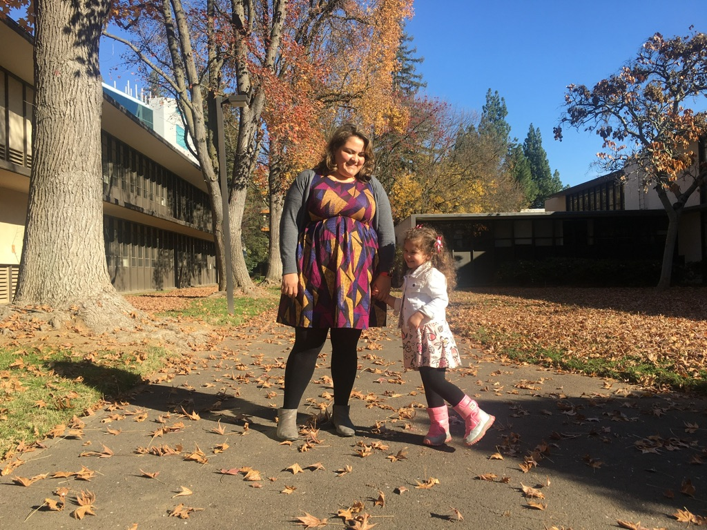 Business administration major Rosa Garcia and her daughter outside of Alpine Hall at Sacramento State Saturday, Dec. 8. Garcia is one of the more than 10 percent of students at Sac State who are juggling being a parent and a student — on top of many other roles.