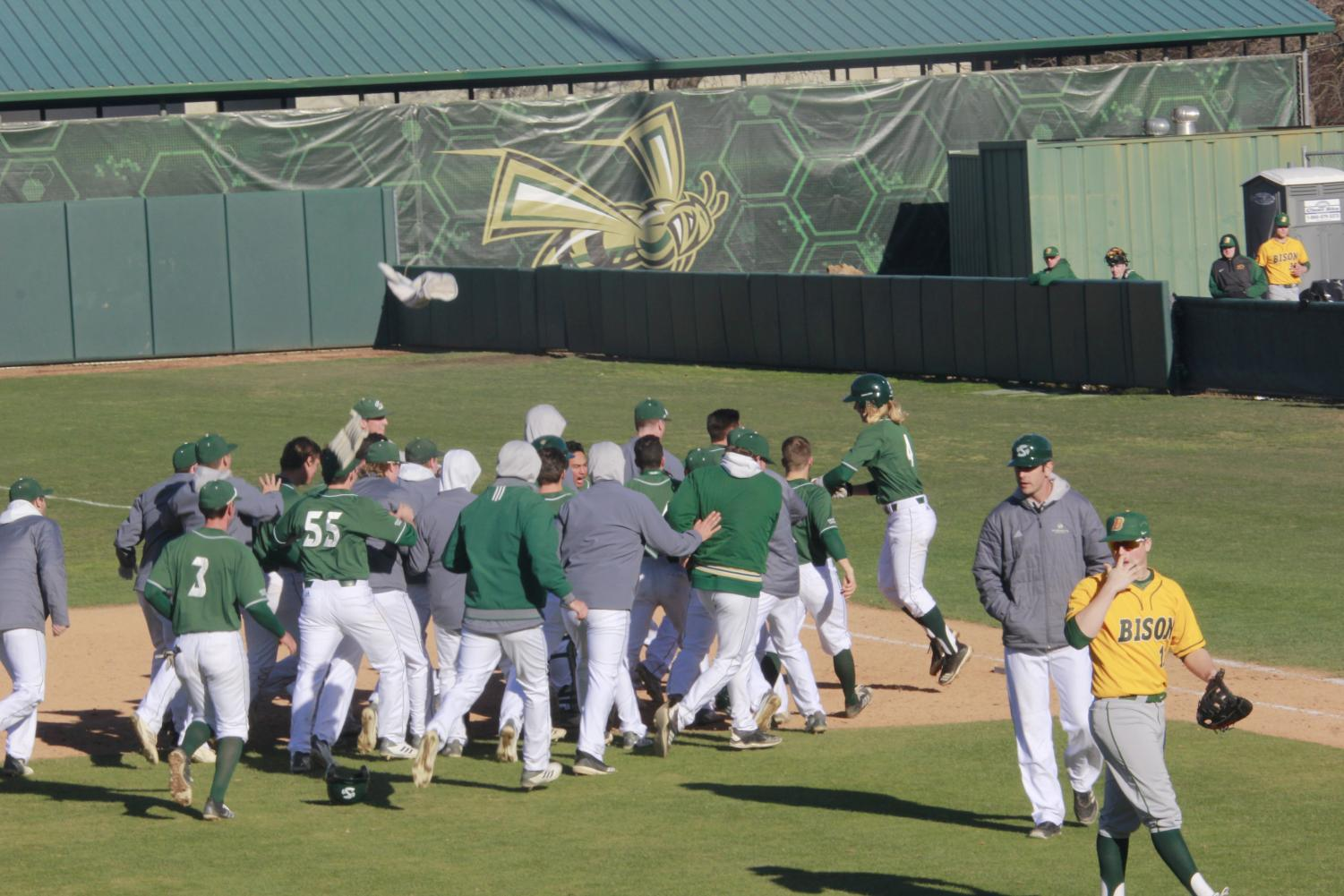 The+Sac+State+baseball+team+celebrate+a+walk-off+hit+by+sophomore+infielder+Nick+Iwasa+in+a+2-1+win+over+North+Dakota+St.+on+Sunday%2C+Feb.+17+at+John+Smith+Field.