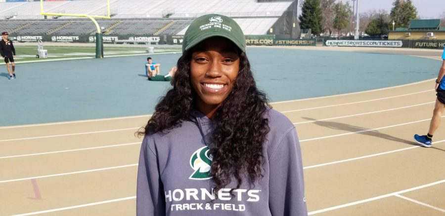 Sophomore+Brittany+Patterson+poses+on+the+track+before+practice+at+Sac+State.+Originally+from+Arizona%2C+she+arrived+with+a+scholarship+to+run+for+Sac+State.