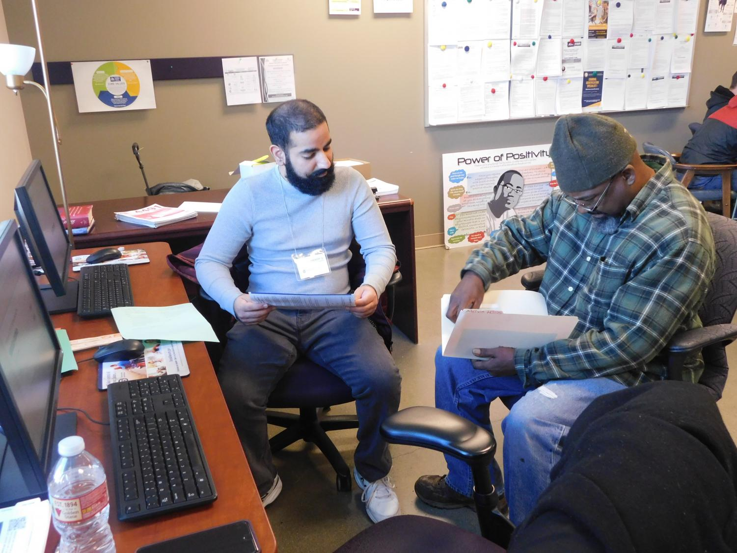 Sac State student volunteer Karandeep Gill assists an attendee with preparing his tax documents. The assistance was part of the free tax preparation event.