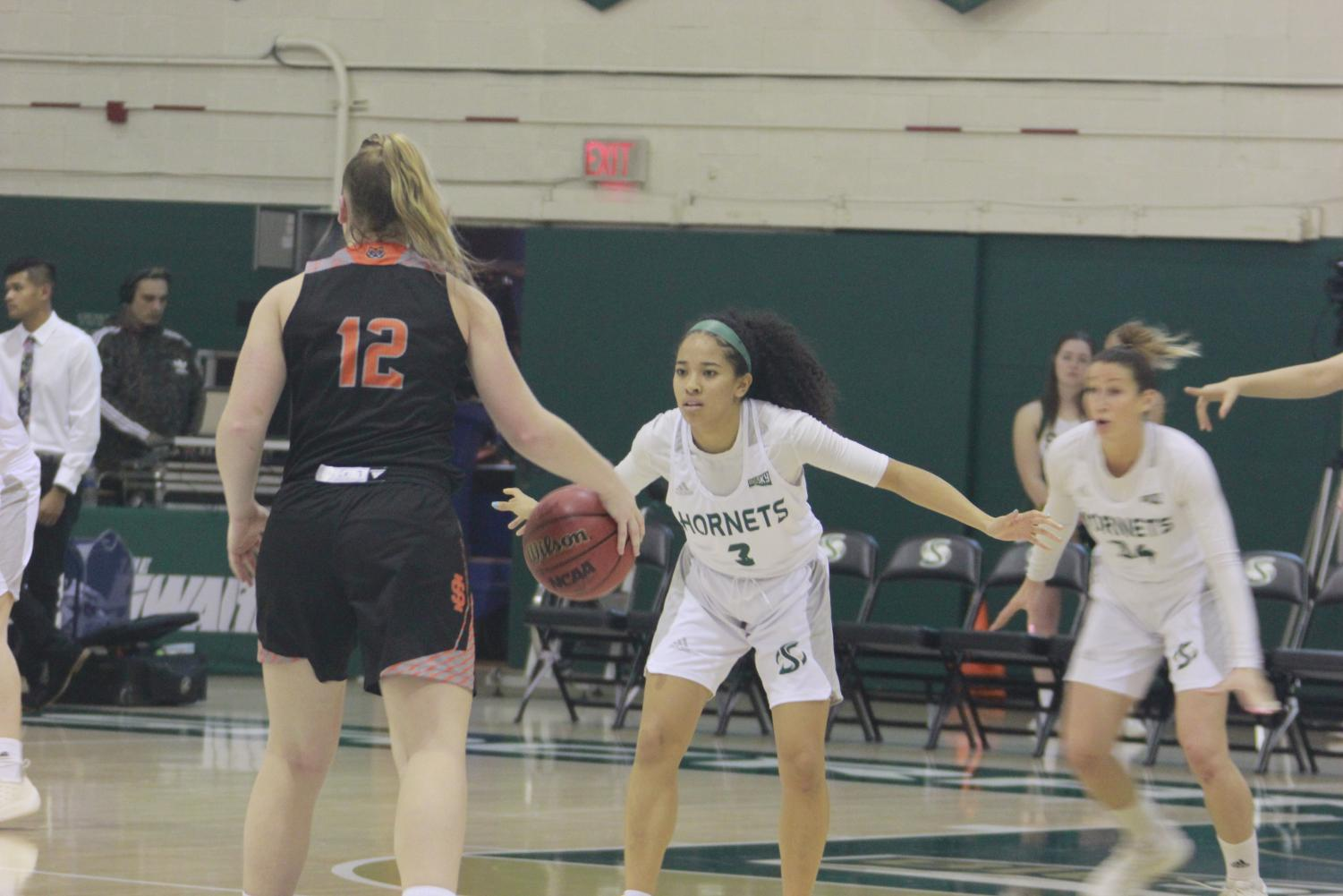 Sac State junior guard Tiara Scott defends Idaho State freshman guard Callie Bourne in a 56-42 loss to the Bengals on Jan. 31. Scott finished with 10 points, 4 assists and 4 steals.