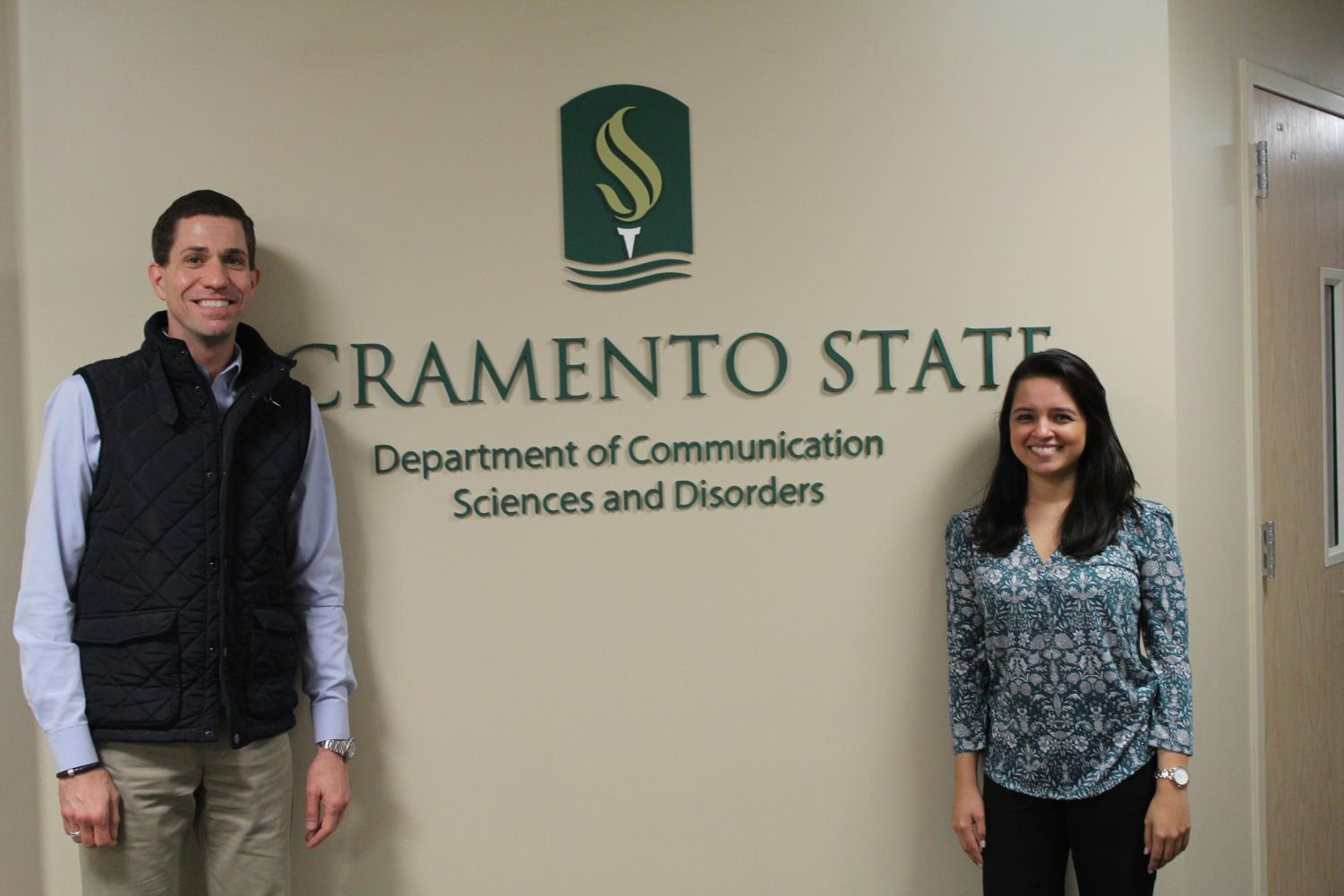 Department Chair of Communication Sciences and Disorders, Robert Pieretti and Laura Gaeta, Doctorate of Audiology director, pose in front of the entryway to their department's office on Jan. 31. The program is available for enrollment by fall 2020.
