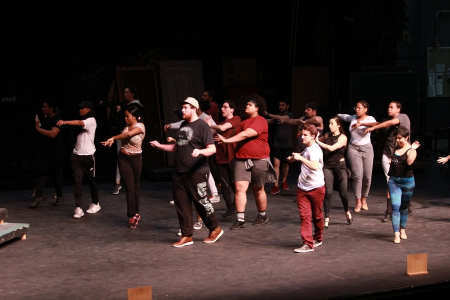 In the Heights' cast warm up for rehearsal. Musical set to premiere March 28. The musical, directed by Ed Brazo, is about a latina girl who gets accepted into Stanford University.