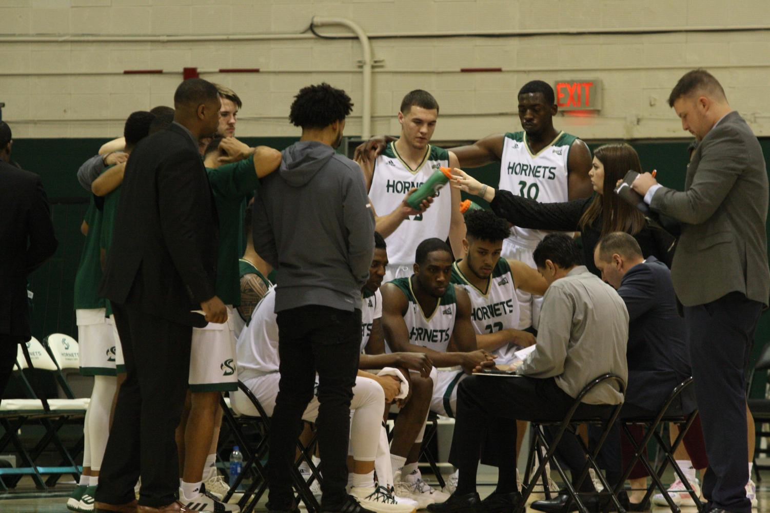 Sac State head coach Brian Katz talks to the Hornets during a timeout. Sac State lost to Northern Arizona 78-66.