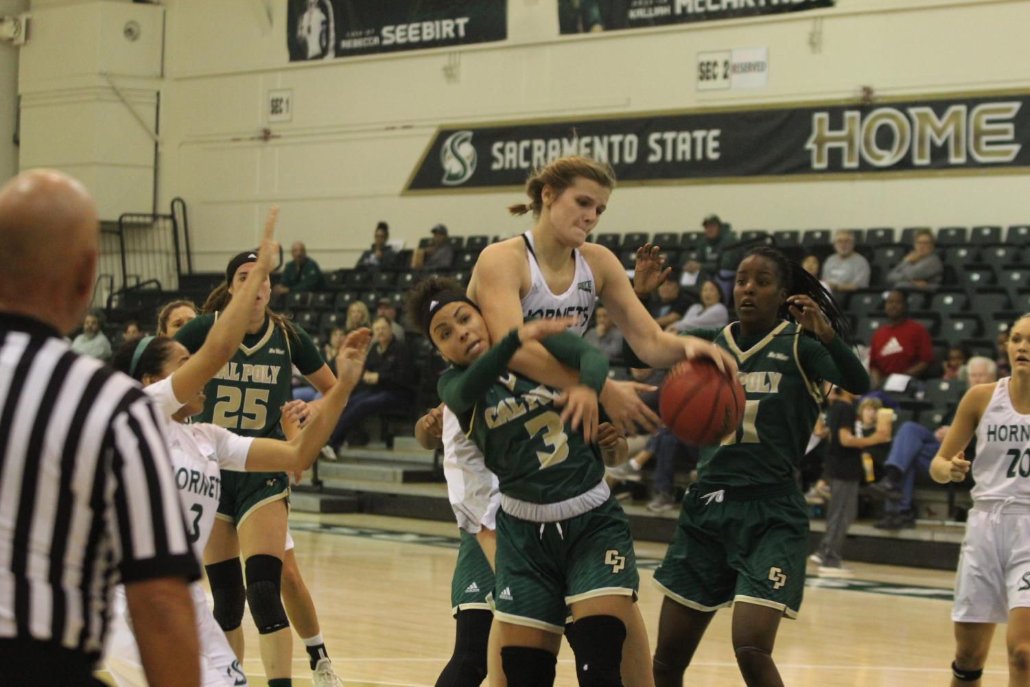 Sac+State+junior+forward+Kennedy+Nicholas+wrestles+for+control+of+the+ball+against+Cal+Poly+senior+guard+Dye+Stahley+in+a+88-85+win+against+the+Mustangs+at+the+Nest+on+Nov.+11.+