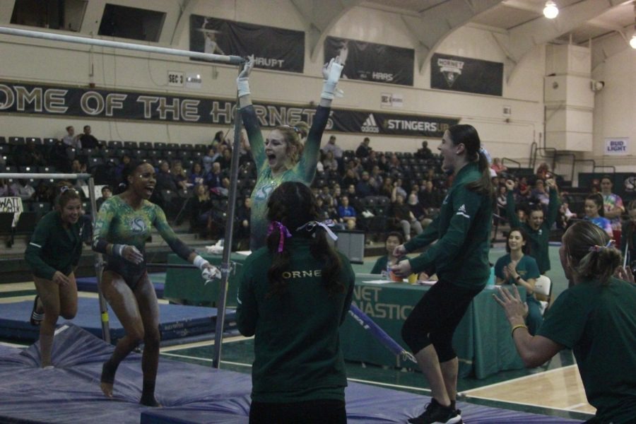 Sac+State+sophomore+gymnast+Courtnee+Marquez+celebrates+with+her+teammates+after+hitting+a+career+high+on+her+uneven+bars+routine.+The+Hornets+recorded+a+season+high+score+of+192.600.+