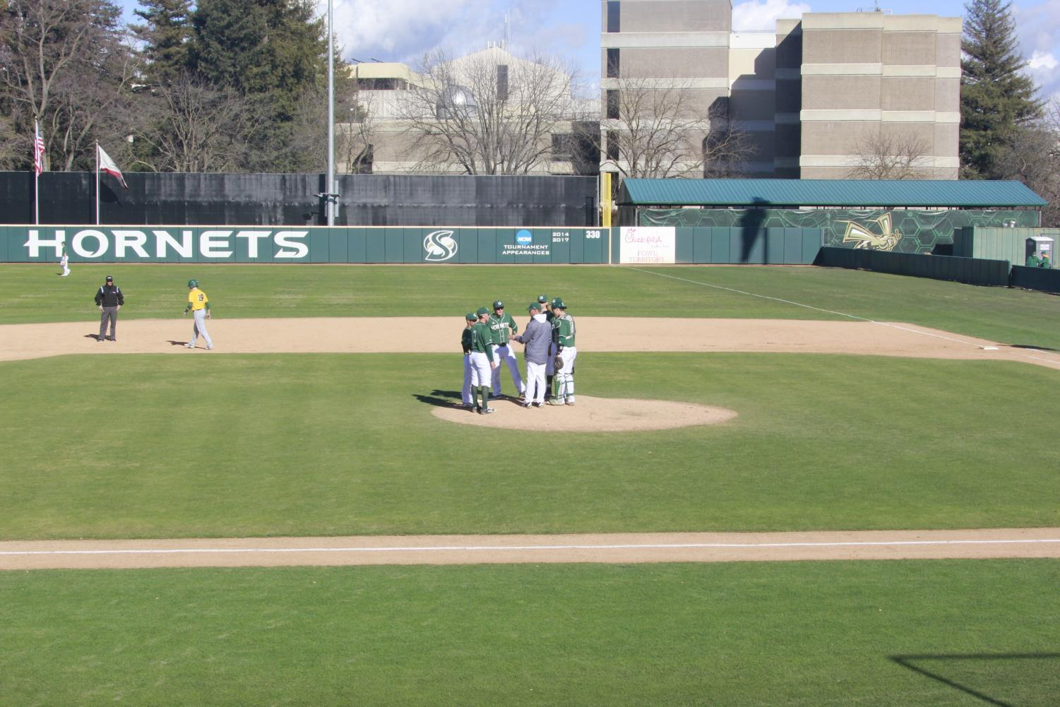 Members+of+the+Sac+State+baseball+team+gather+on+the+pitchers+mound+during+a+2-1+win+over+North+Dakota+St.+on+Sunday%2C+Feb.+17+at+John+Smith+Field.