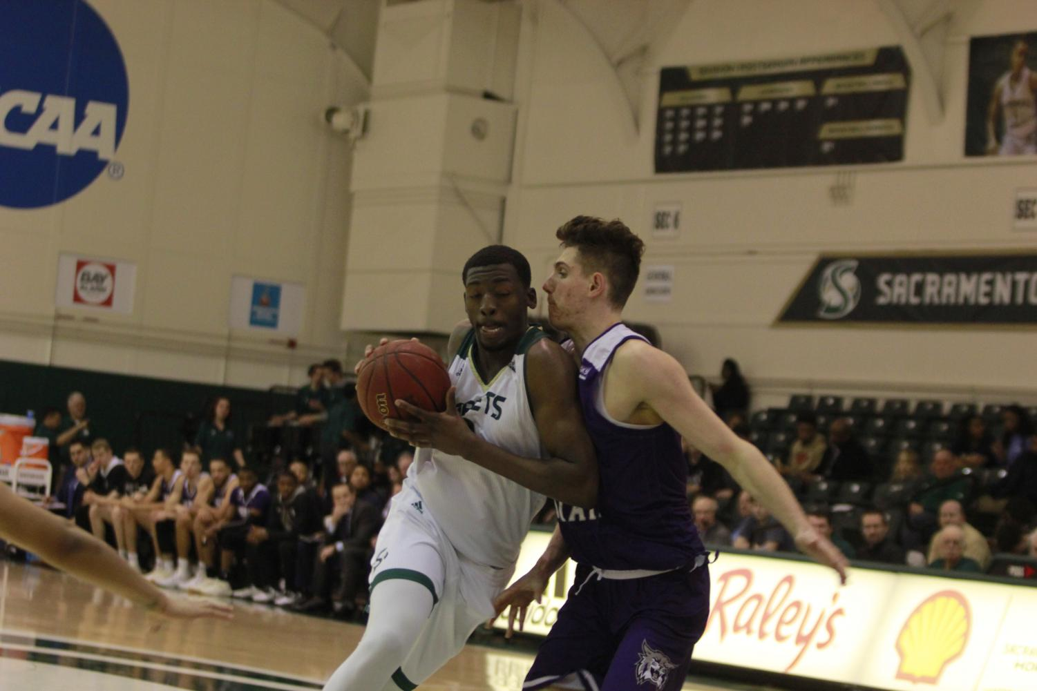 Sac State junior center Joshua Patton drives towards the basket in the Hornets 78-76 win over Weber State on Thursday.
