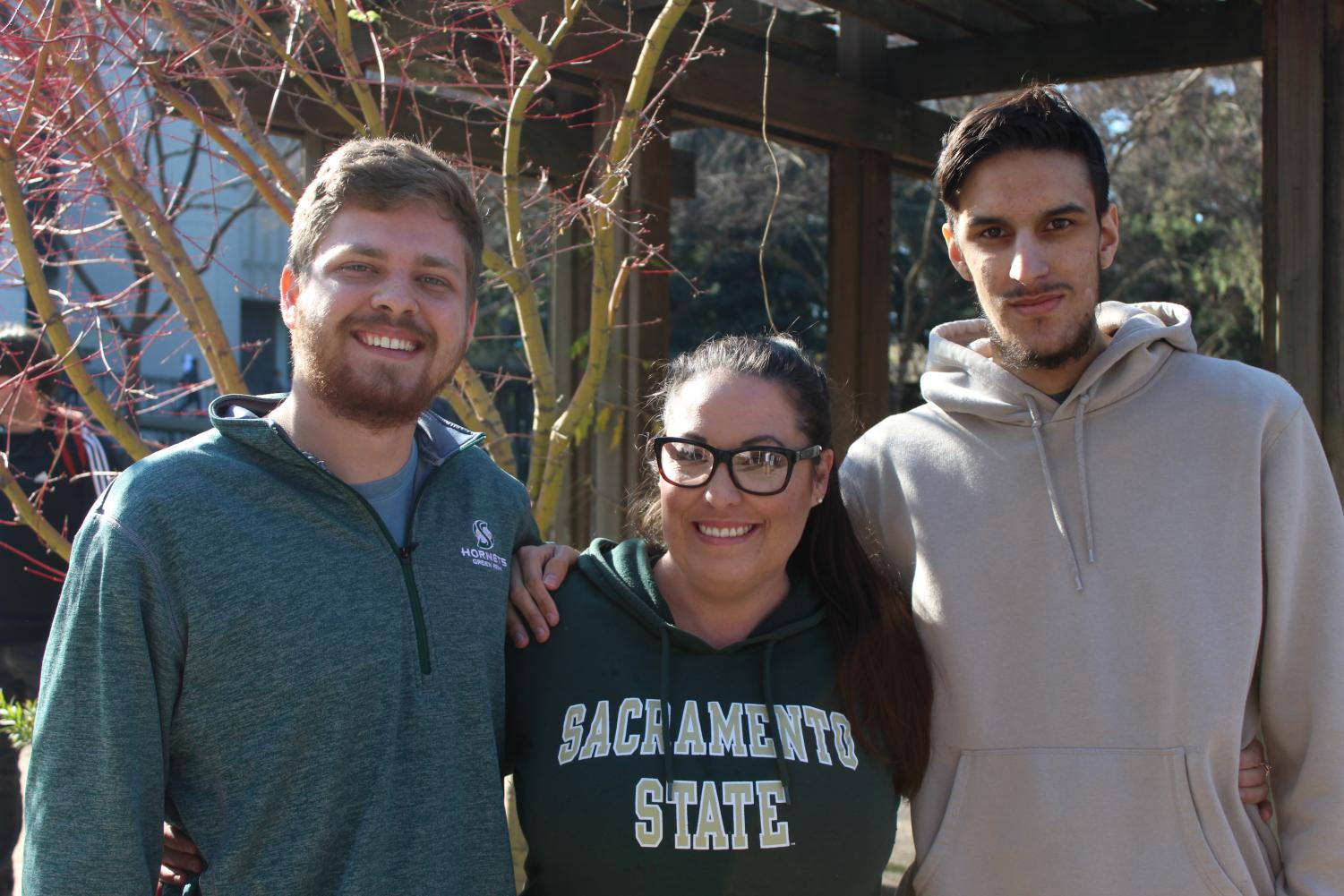 From left to right, Nick Palsgaard, Donna Walters, and Paul Mello stand near the library quad near their booth during club rush. They, along with club members, work toward expanding eSports at Sac State by competing in gaming tournaments.