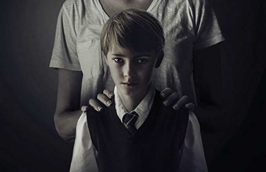 A+story+about+a+child+who+is+connected+to+a+serial+killer.+A+movie+that+gives+too+much+too+soon.%0A
