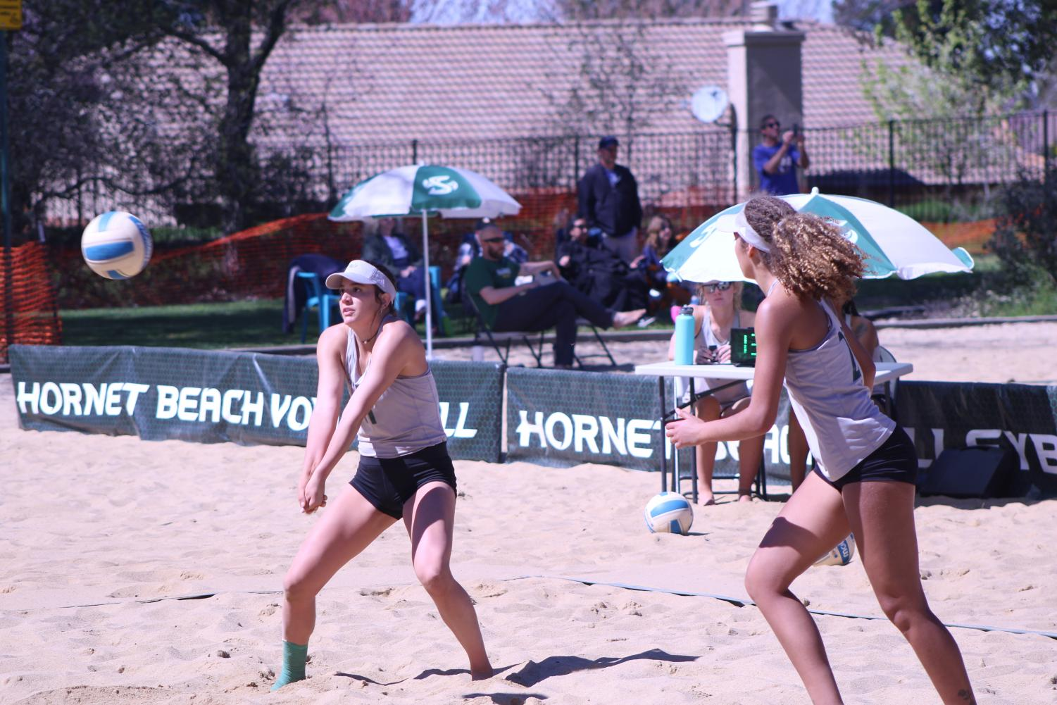 Sac State junior Paige Swinney gets in position to bump set the ball as sophomore Macey Hayden looks on in anticipation to make a play off the set. Sac State women's beach volleyball went 1-3 in its first two-day tournament this season at Livermore Park in Folsom on Saturday, moving their record to 1-6 overall.