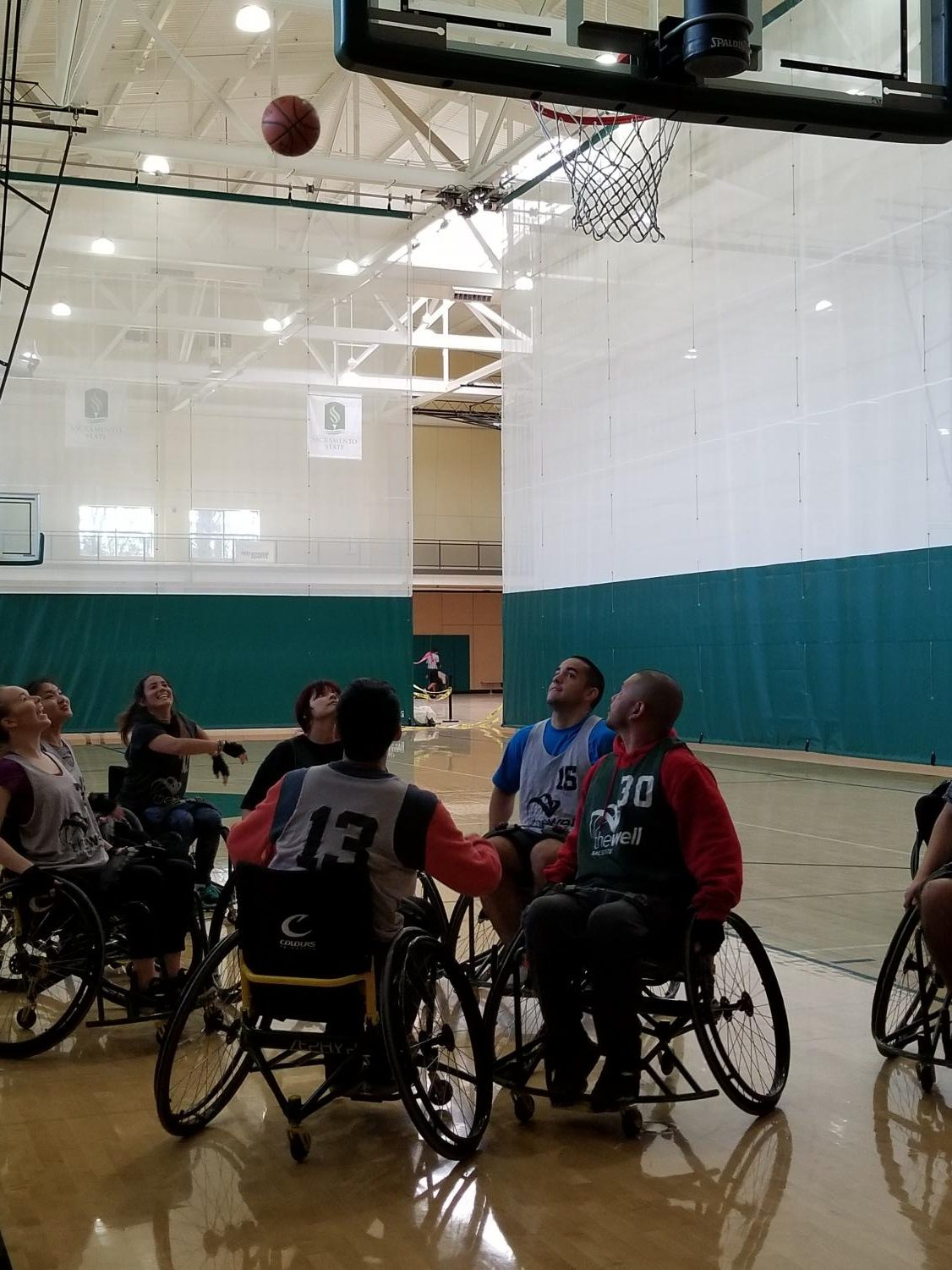 One student hoisted a shot while others away the rebound during All-In-Recreation's adaptive basketball on Feb. 15, 2019 in The WELL.