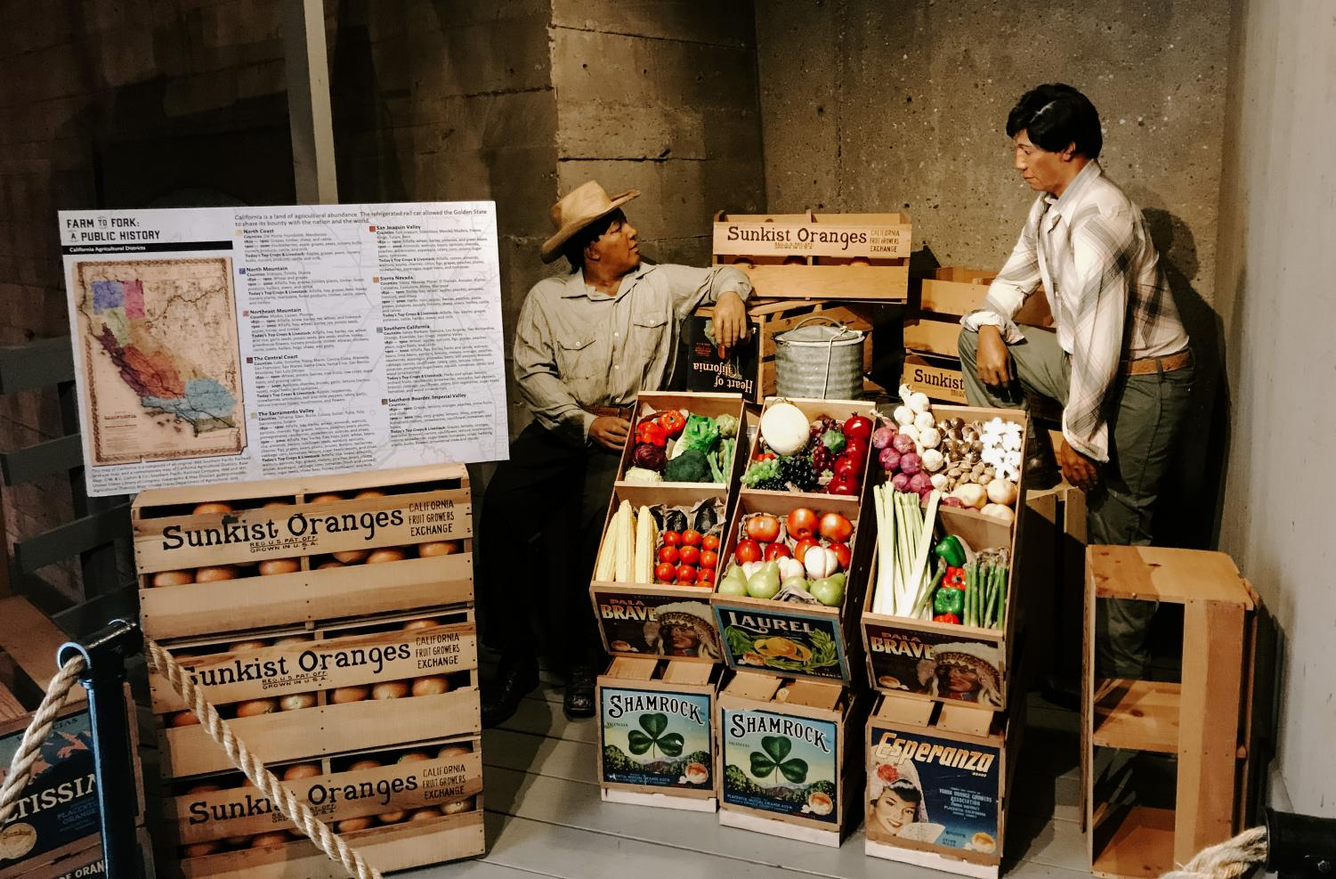 An arrangement of artifacts was placed inside a showcased refrigerator car at the California State Railroad Museum in Sacramento. Chinese immigrants who came to California transformed the land and produced a variety of fruits and vegetables.
