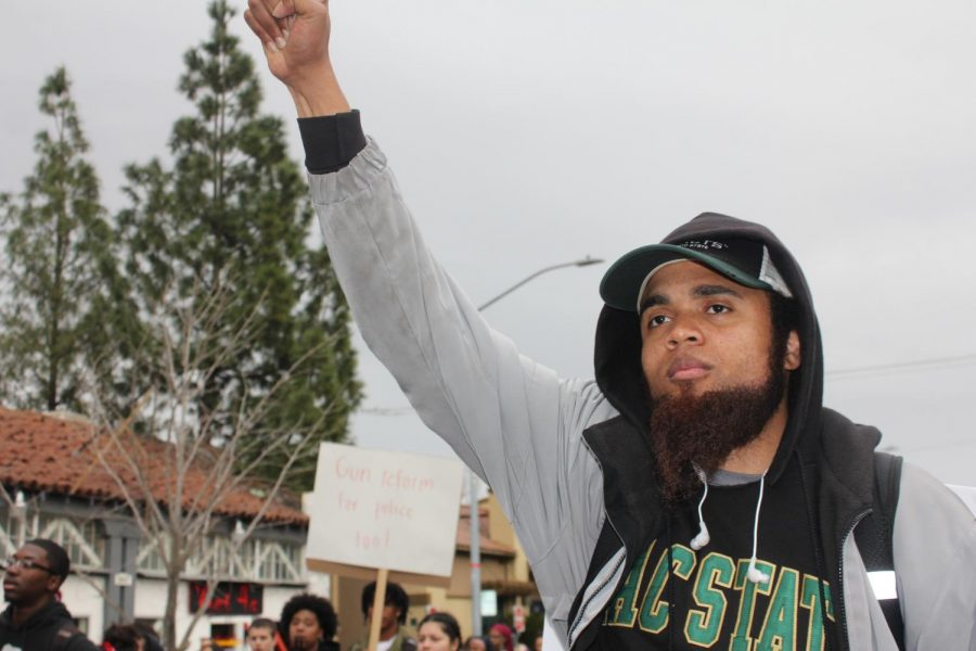 Sac+State+student+Ronnie+Guice%2C+a+history+major%2C+joined+the+student+walkout+from+Sac+City+College+to+the+Capitol+protesting+the+Stephon+Clark+decision+Thursday%2C+March+7.+Guice+said+the+history+of+the+U.S.+was+one+of+genocide+in+various+forms%2C+like+rape%2C+murder%2C+ordinances%2C+and+laws+contributing+to+the+oppression+of+certain+groups.+