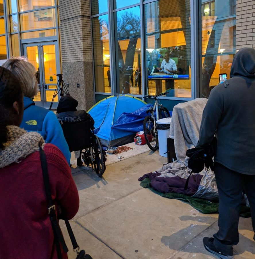 Attendees+unable+to+enter+City+Hall+meeting+watch+the+proceedings+from+a+television+outside+Tuesday.+Large+crowds+arrived+at+city+hall+to+express+their+frustration+with+the+District+Attorney%27s+choice+to+not+press+charges+against+the+two+officers+who+shot+and+killed+Stephon+Clark+and+Sacramento+PD%27s+handling+of+Monday+night%27s+demonstrations.