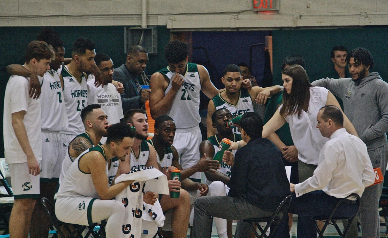 The Sac State men's basketball team listens to head coach Brian Katz during a timeout on Thursday. The Hornets defeated Montana State 70-67 to improve its record to 14-14.