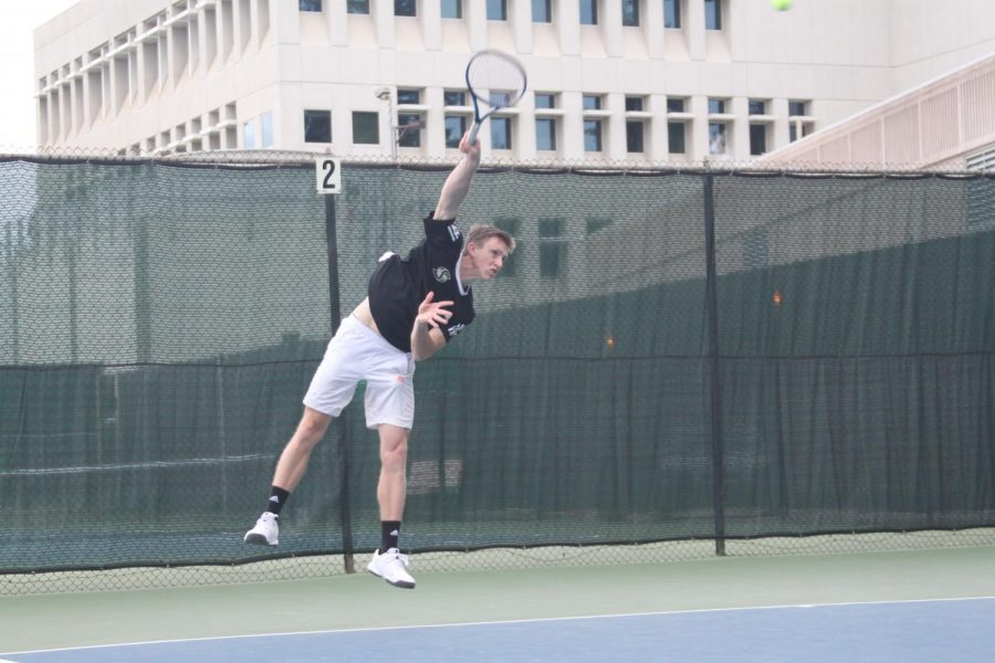Senior Sac State men's tennis player Mikus Losbergs, swings against Nevada. Losbergs has a record of 4-4 this season.