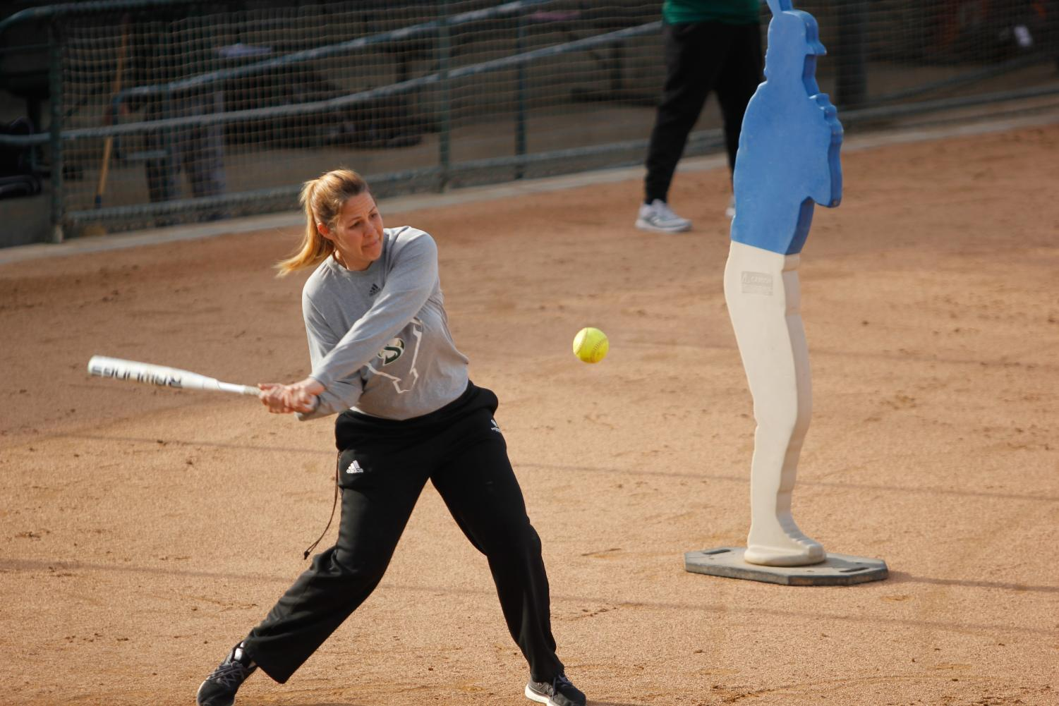 Coach Lori Perez hitting a softball while conducting fielding drills during practice at Shea Stadium on Jan. 31, 2018. Perez is one of the only two women head coaches at Sac State.