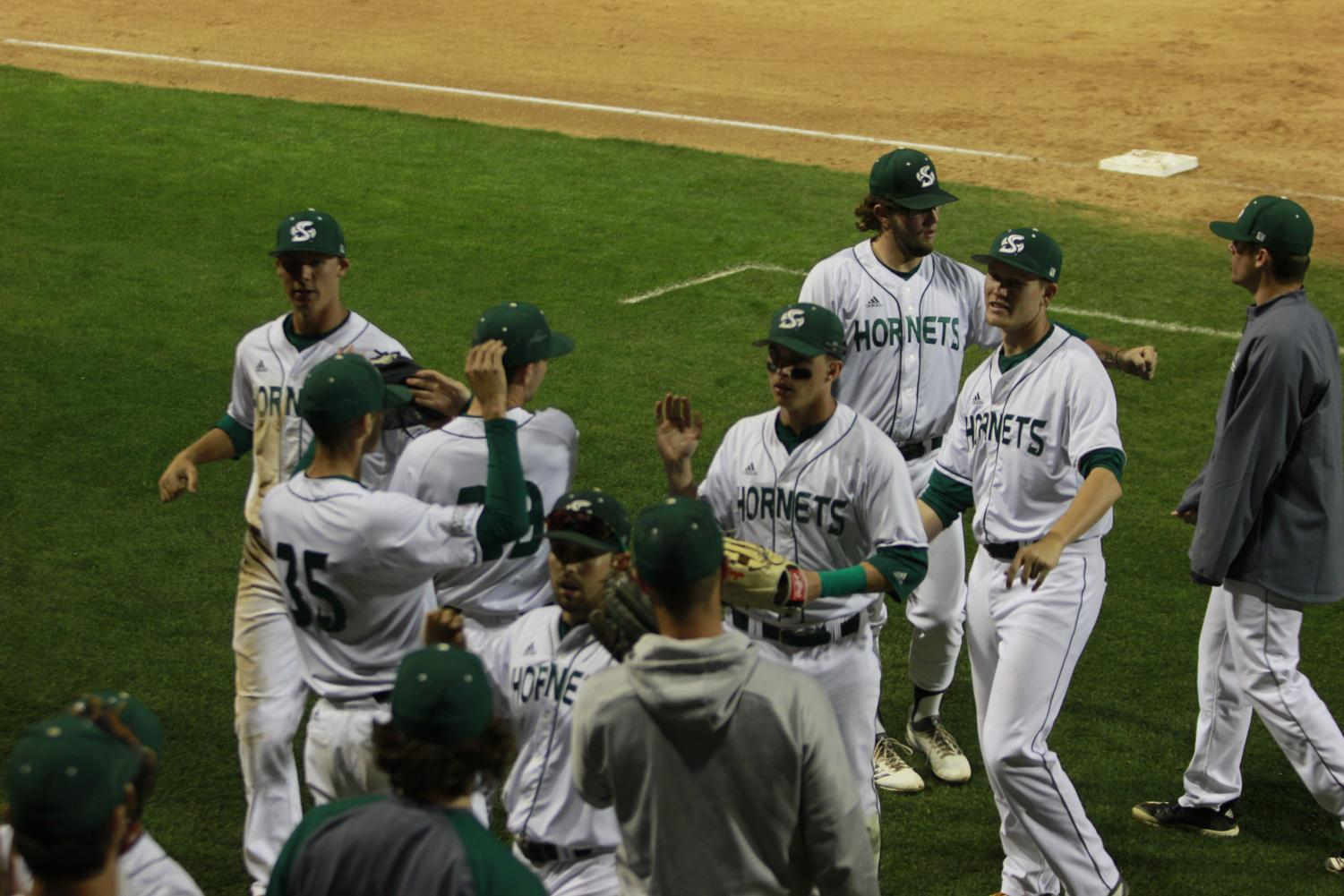 Members+of+the+Sac+State+baseball+team+congratulate+each+other+upon+returning+to+the+dugout+following+a+successful+inning+in+a+6-0+win+over+Cal+Tuesday+at+John+Smith+Field.+The+Hornets+went+12-1+on+a+season-long+13+game+homestand.