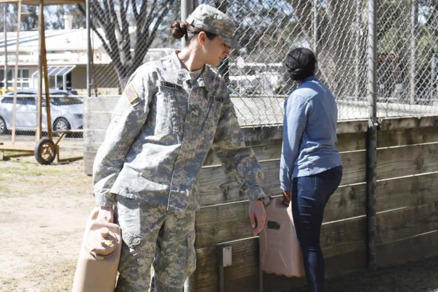 Carissa Summers carries a water jug near the grounds for the Sac State ROTC program. Summers gets up at 4:45 a.m. for physical training three days a week, and recently hit personal highs.