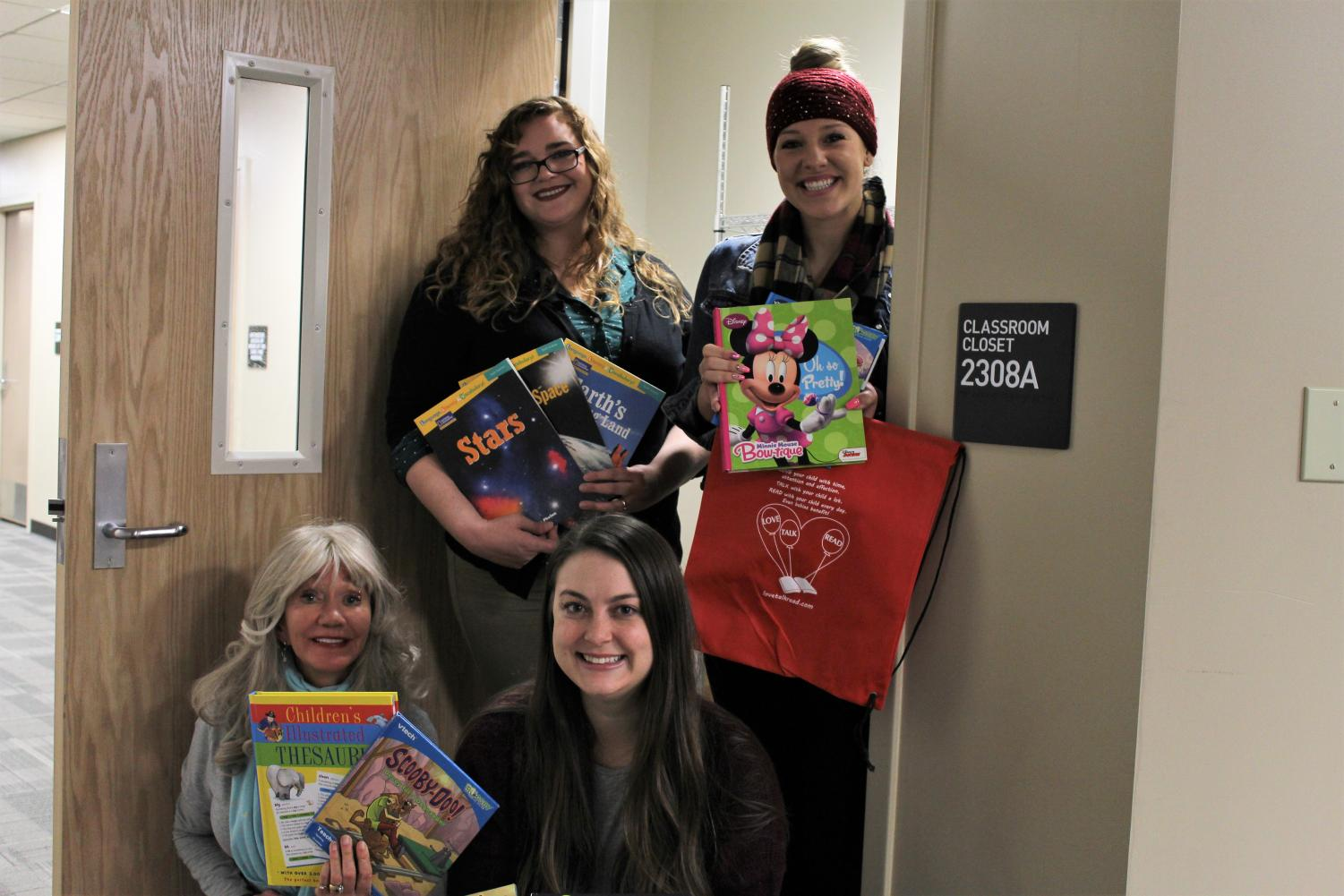 From+left%2C+professor+Celeste+Rosberry-McKibbin%2C+Mary+Persons%2C+Kirstin+FitzGerald+and+Marisa+Dix+stand+in+the+doorway+of+the+book+donations+closet.+All+of+the+donations+are+stored+in+a+broom+closet+in+Folsom+hall+until+Persons+personally+drives+the+books+up+to+Paradise.