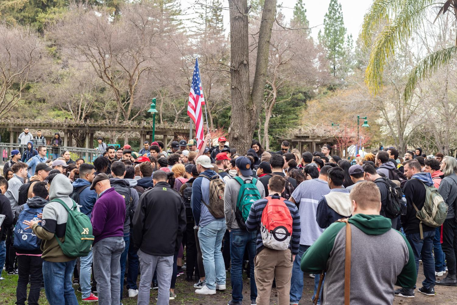 A+crowd+of+nearly+200+gathered+in+the+Library+Quad+after+a+fight+broke+out+at+Sac+State+Thursday+after+a+group+of+men+wearing+Make+America+Great+Again+hats+with+a+Blue+Lives+Matter+flag+accused+The+State+Hornet+of+inciting+violence+in+its+latest+print+issue.