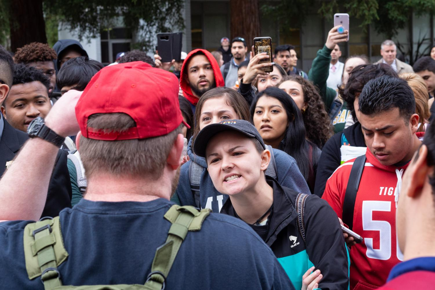 Sac+State+student+Lauren+Pulido+argues+with+Philip+Olding+about+whether+or+not+President+Donald+Trump+is+racist+in+the+Library+Quad+Thursday.+A+fight+broke+out+at+Sac+State+after+a+group+of+men+wearing+Make+America+Great+Again+hats+with+a+Blue+Lives+Matter+flag+accused+The+State+Hornet+of+inciting+violence+in+its+latest+print+issue.