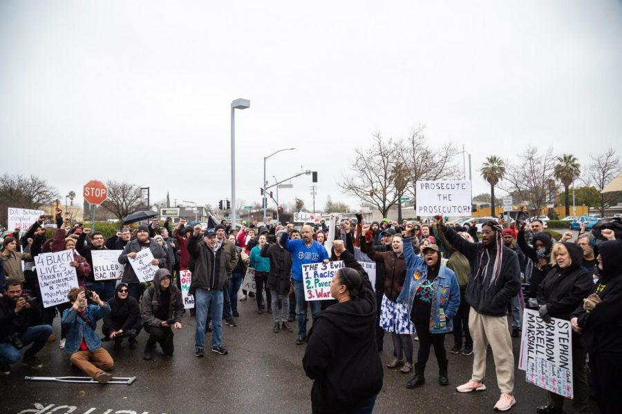Tanya+Faison%2C+Sacramento%27s+Chapter+Leader+for+Black+Lives+Matter+chants+with+group+of+protestors+%22It+is+our+duty+to+fight+for+our+freedom.+It+Is+our+duty+to+win.+We+must+love+and+support+one+another.+We+have+nothing+to+loose+but+our+chains%2C%22+on+March+2+outside+the+Sacramento+Police+Department+headquarters.