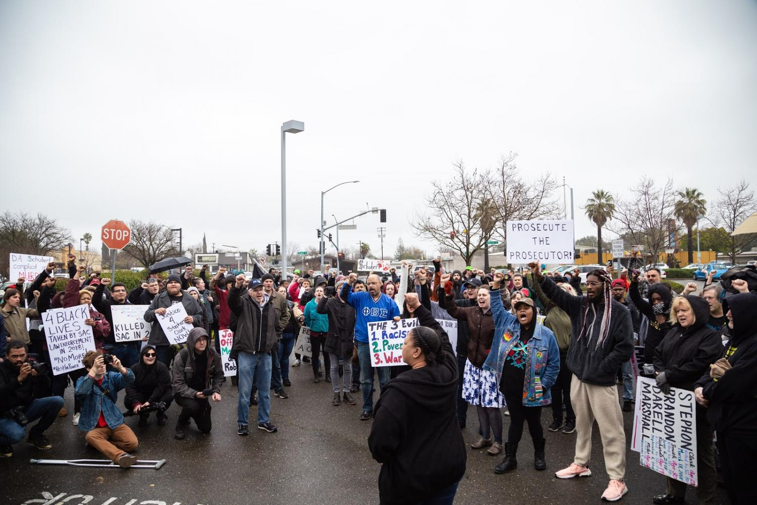 Tanya Faison, Sacramento's Chapter Leader for Black Lives Matter chants with group of protestors