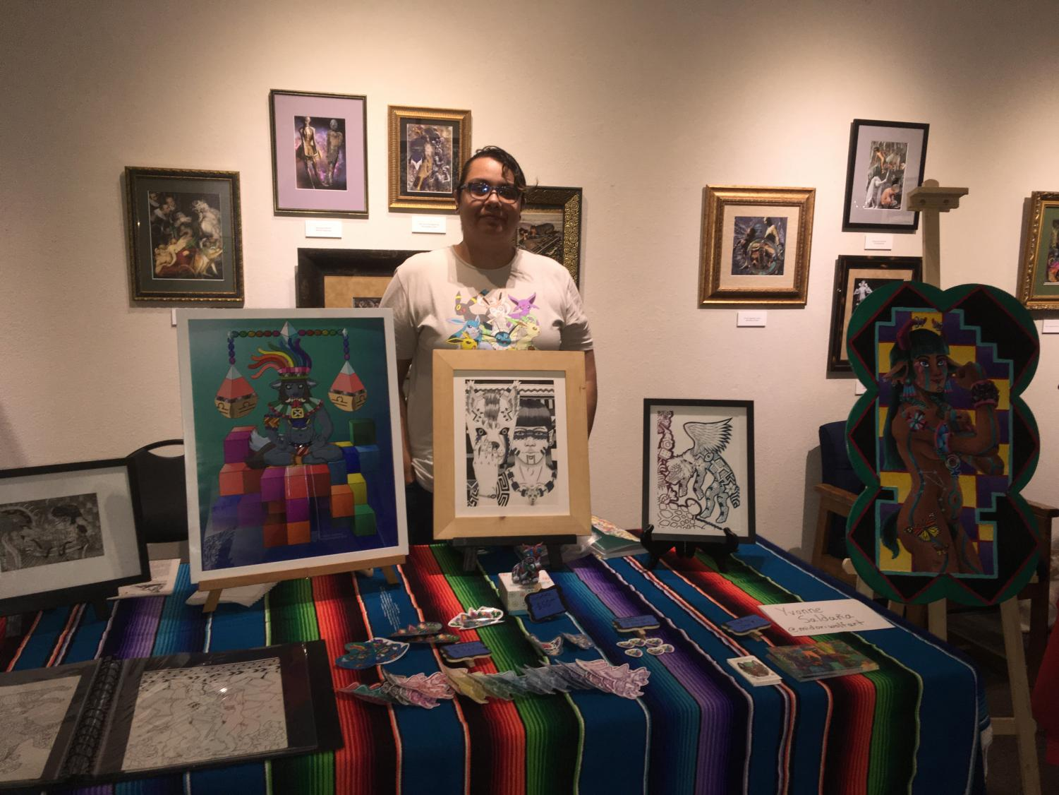 Yvonne Saldana, 2018 graduate of Sac State and art major, displays her work at the University Library Gallery on Wednesday. The Task Force for the Center on Race, Immigration, and Social Justice put this event together bring light to the topic of immigration.
